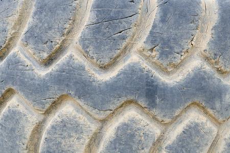 tyre tread: Close-up of damaged heavy dump truck tyre