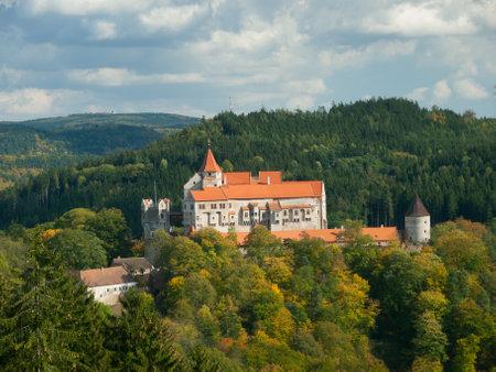 gothic castle: Pernstejn gothic castle in the autumnal forest, Czech Republic Editorial