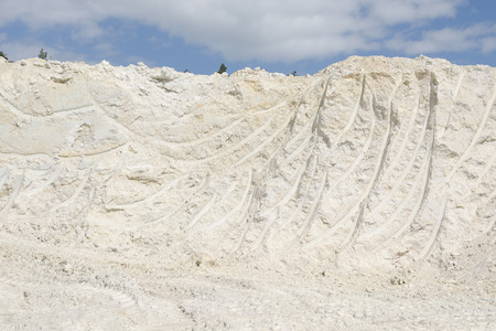 an excavation: Kaolin excavation for ceramics and paper industry