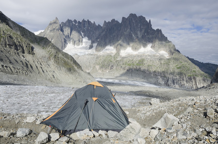 crack climb: Green tent on the Leschaux glacier in the French Alps