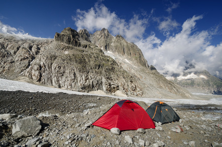 crack climb: Camping on Leschaux glacier in the french Alps