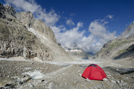 Camp with a red tent on the Leschaux glacier in the french Alps
