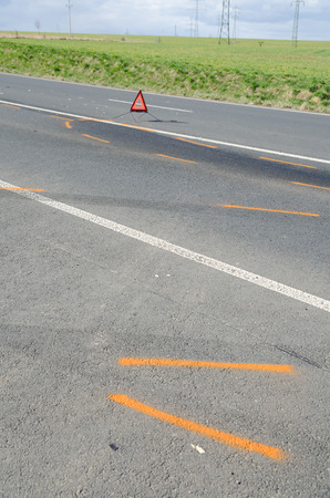 Warning triangle and drift marker on the road after the accident