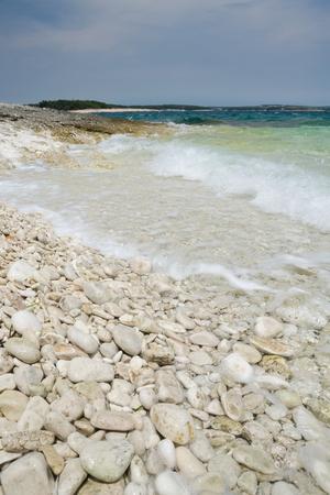 Limestone rocky coast with waves, Istria peninsula, Croatia