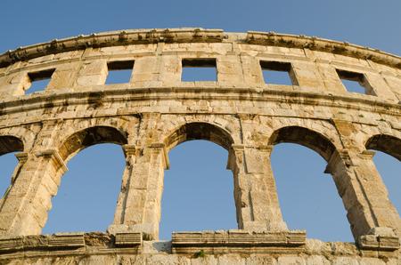 Ancient arcs of Roman empire colosseum in Pula, Croatia