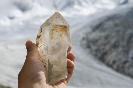 Freshly found clear quartz crystal on the glacier in the French Alps Stock Photo
