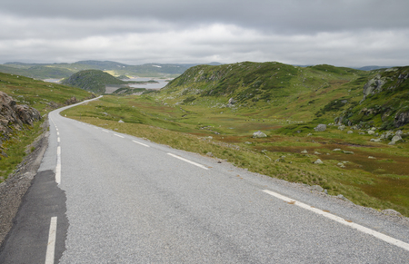 Tarmac road over the hills and bogs of the Vest-Agder, Norway