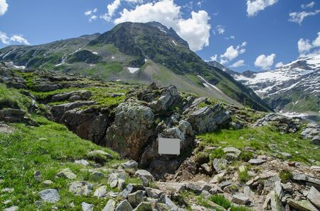 Abandoned gold mine tunnel with the Hohe Sonnblick peak in the background, Hohe Tauern NP, Austria