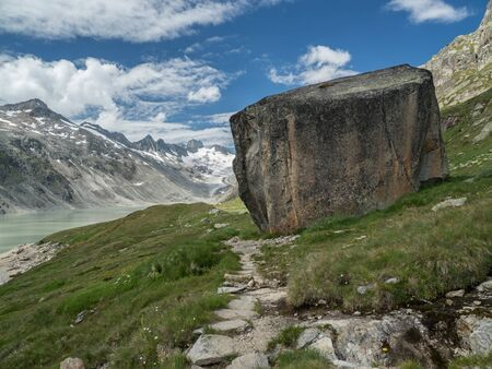 Hiking trail along the Oberaarsee lake near Grimsel Pass, Switzerland