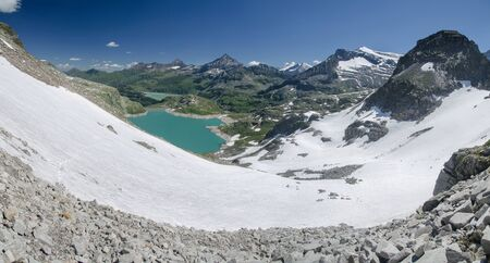 Alpine landscape with glacier, lake and snowy peaks in Hohe Tauern NP, Austria