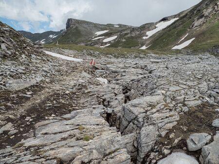 Alpine landscape with limestone rocks and snowy peaks, Hohe Tauern NP, Austria