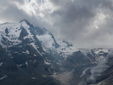 Cloudy and rainy Alpine landscape with Grossglockner peak and Pasterze glacier, Hohe Tauern national park, Austria