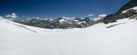 Alpine landscape with hiking trail over snow covered glacier, Hohe Tauern NP, Austria