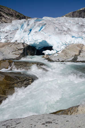 Mouth of Nigardsbreen glacier with wild meltwater river and rocks, Norway, Scandinavia Standard-Bild