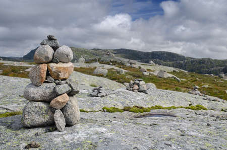 Rocky and mountainous tundra landscape with cairns near Lysebotn, Norway, Scandinavia