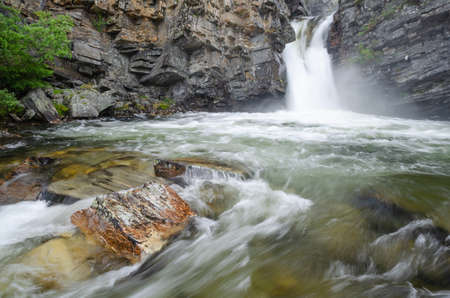 Wild waterfalls in the rocky gorge on the Store Ula river, Rondane national park, Norway Standard-Bild