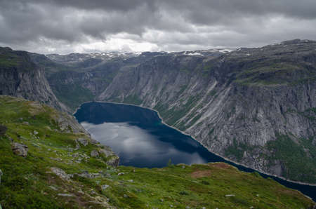 Rocky hills and Ringedalsvatnet lake on the hike to Trolltunga, Hardangervidda, Norway