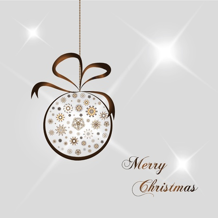gold christmas ball with snow on white background