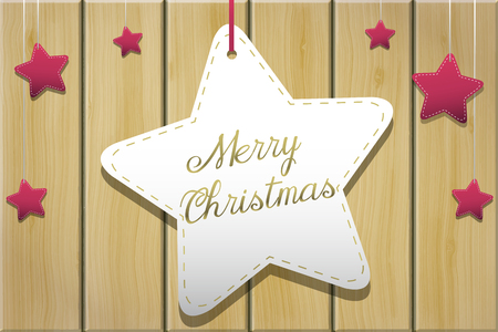 Christmas greeting with hanging stars over a wooden planks background Zdjęcie Seryjne
