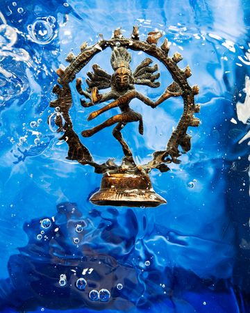 hindu god shiva: Statue of the Hindu God Shiva in Blue Water  Stock Photo