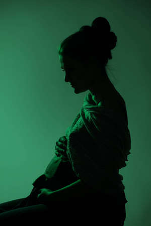Silhouette of a pregnant woman on green background Stock Photo - 14117869