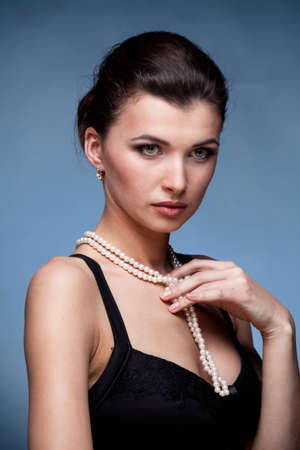 Portrait of luxury woman in exclusive jewelry on natural background Stock Photo