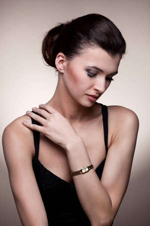 Portrait of luxury woman in exclusive jewelry watch on natural background Stock Photo