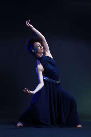 Beautiful dancer girl wearing blue dress Stock Photo