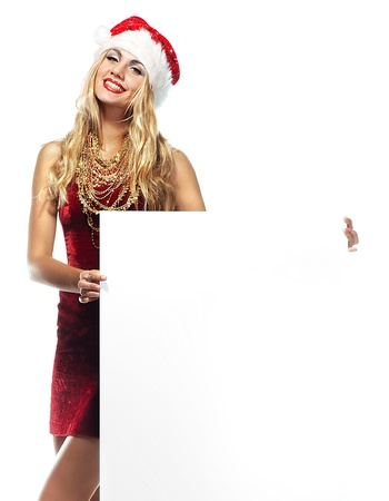 Beautiful christmas woman in Santa Clause costume with empty blank board