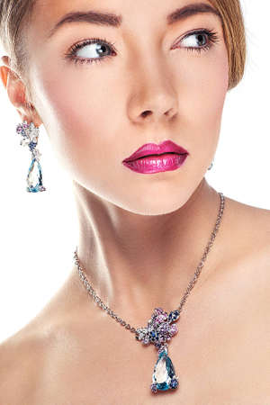 Glamour portrait of  beautiful  fashion model posing in exclusive jewelry  Professional makeup and hairstyle photo