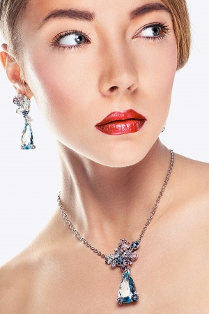 Woman posing in exclusive jewelry  Professional makeup photo