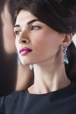 Woman posing in exclusive jewelry  Professional makeup