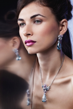 Glamour portrait of beautiful fashion model posing in exclusive jewelry  Professional makeup and hairstyle