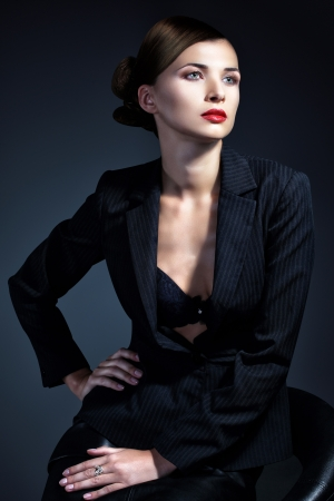 Portrait of sexy business woman in a suit  Professional makeup and hairstyle