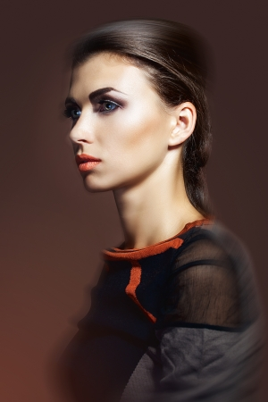 Fashion studio shot of beautiful woman  with a luxurious hairstyle and professional makeup