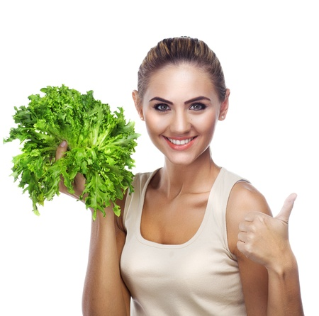 Close-up portrait of happy young woman with  bundle herbs  salat  in hands on white background   Concept vegetarian dieting - healthy food