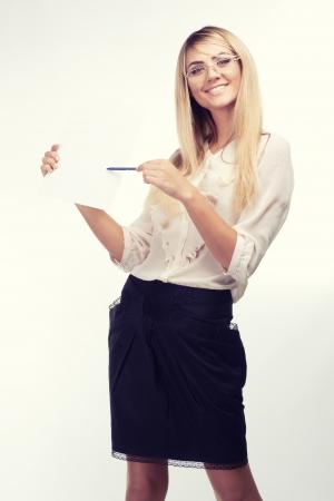 Portrait of happy woman with travel magazine photo