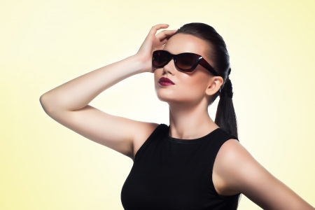 close-up portrait of beautiful and fashion girl in sunglasses, studio shot