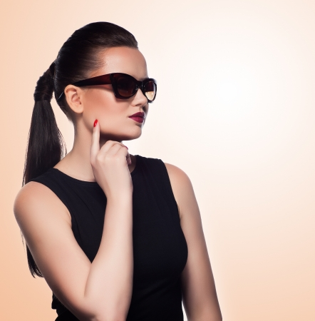 close-up portrait of beautiful and fashion girl in sunglasses, studio shot  Professional makeup and hairstyle