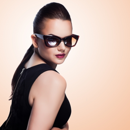 close-up portrait of beautiful and fashion girl in sunglasses, studio shot Stock Photo - 20667938
