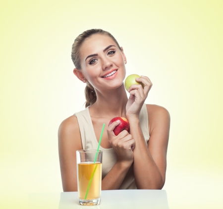 Close-up portrait of happy young woman with apple juice on white background  Concept vegetarian dieting - healthy food