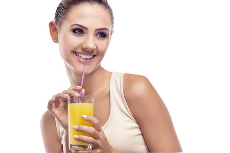 portrait of happy young woman with juice on white background.  Concept vegetarian dieting - healthy food