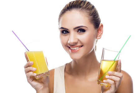 portrait of happy young woman with juice on white background   Concept vegetarian dieting - healthy food  Stock Photo