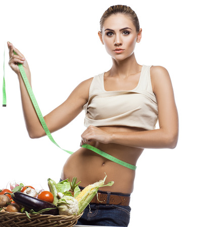 Happy young woman holding basket with vegetable. Concept vegetarian dieting - healthy food Stock Photo