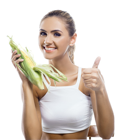 happy young woman with corncob on white background  Concept vegetarian dieting - healthy food Stock Photo