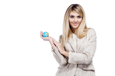 Pretty smiling woman holding a world globe and  dreaming about traveling  Business woman