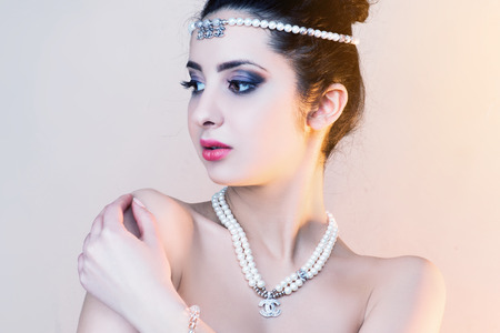 Portrait of a beautiful brunette girl with luxury accessories Beauty with jewellery