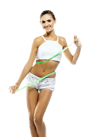 Young woman in perfect shape with green measure doing yoga poses  Concept healthy lifestyles Stock Photo