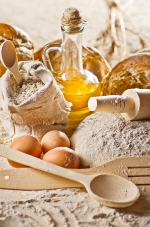 Still life with oil, bread and spoon Stock Photo - 16573256
