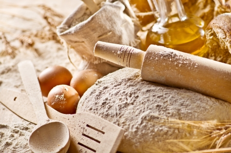 Still life with rolling-pin, eggs and oil bottle Stock Photo